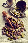 image of cardamom  - Coffee beans and cardamom on burlap a - JPG