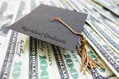 picture of graduation  - High School Graduate mini graduation cap on cash - JPG