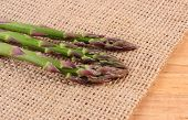 picture of immune  - Fresh green asparagus on burlap bag concept of healthy food nutrition and strengthening immunity - JPG