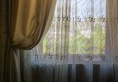 stock photo of gathering  - gathered curtains and blinds on the window of the room - JPG