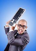 picture of nerds  - Nerd businessman with computer keyboard against gradient  - JPG