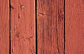 stock photo of red barn  - weathered vertical red barn boards for background use - JPG