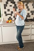 picture of pregnant woman  - Beautiful pregnant woman having a bowl of yogurt and fruit for lunch - JPG