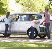 stock photo of car carrier  - Father And Daughters Washing Car Together - JPG