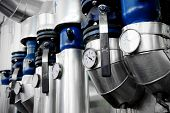 foto of pipeline  - Industrial shot with a manometers and heating pipelines inside a water heating station - JPG