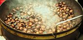 foto of pot roast  - large pot containing roasted chestnuts worm and steaming  - JPG