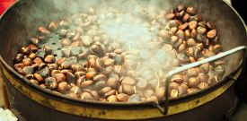 stock photo of pot roast  - large pot containing roasted chestnuts worm and steaming
