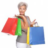 pic of senior adult  - Full isolated portrait of a senior woman with shopping bags - JPG