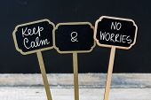 Keep Calm And No Worries Message Written With Chalk On Mini Blackboard Labels poster