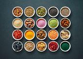 Various colorful superfoods as acai powder, turmeric, matcha green tea, spirulina, quinoa, pumpkin s poster