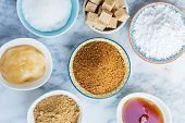 Different Kinds Of Sugar And Sweeteners In The Bowls poster