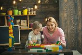 Enjoy Concept. Mother And Child Enjoy Playing With Toy Bricks. Mother And Son Learn To Enjoy And Enj poster