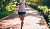 Healthy Woman Runner Running On Morning Park Road Workout Jogging poster