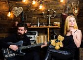 Couple In Love On Relaxed Faces Enjoy Romantic Atmosphere. Man Play Guitar While Lady Holds Teddy Be poster