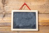 Blank Blackboard With Frame On Wooden Wall Background poster