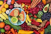 Food for good heart health with fresh fish, fruit, vegetables, herbs, nuts and olive oil. Super food poster
