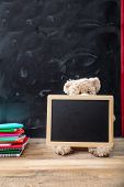 Back To School. Teddy Bear And Blank Blackboard With Frame On Wooden Desk poster
