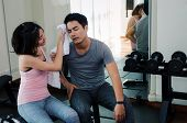 Young Asian Woman Helping Wipes Sweat Off Muscular Young Handsome Man Face While Resting After Worko poster