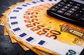 Euro Money. Euro Cash Background. Lots Of Euro Money On The Calculator. Euro Banknotes Background Of poster