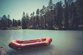 Inflatable Boat On Water On The River Or Lake Near The Shore In A Clear Summer Day, The Bright Refle poster