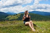 Beautiful Smiling Woman Hiker Hiking Mountain Trail, Resting On Grassy Hill With Trekking Sticks, We poster