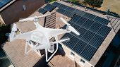 UAV Drone Inspecting Solar Panels On Large House. poster