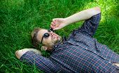 Nature Fills Him With Freshness And Inspiration. Man Unshaven Guy Lay On Green Grass Meadow. Natural poster