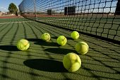 image of deuce  - An image depicting the concept of tennis including the court and balls at sunset - JPG