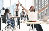 Young Businessman Raising Both Hands Looking Happy Surrounded By Group Of Business Persons Clapping  poster