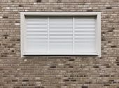 Wall With Closed Window With Rolling Shutters Or Roller Blinds poster