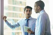 Two Employees Discussing Meeting With Boss. Indian And Afro American Men In Formal Shirts Ties Stand poster