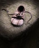 picture of bereavement  - detail of child shoe on rock as a symbol of loneliness - JPG