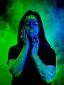 Female Caucasian Model With Plant Inspired Green Blacklight Paint Glowing. Brightly Colored Smoke Fl poster