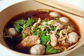 stock photo of thai food  - bowl of thai style beef noodle soup - JPG