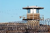 foto of freedom tower  - Prison guard and guard stand on the edge of the Oregon State Prison in Salem Oregon - JPG