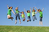 image of happy kids  - happy healthy smiling group of kids children jumping for joy at summer camp - JPG