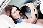 stock photo of turn-up  - Portrait of pretty female driver turning back - JPG
