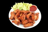 image of chicken wings  - crispy chicken wings with hot and spicy barbecue dipping sauce and lettuce - JPG