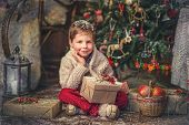 picture of santa baby  - boy  with a basket of toys in the background of a beautiful Christmas tree - JPG