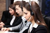 stock photo of telephone operator  - Call center operators at work - JPG