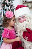 stock photo of saint-nicolas  - little girl talks to Saint Nicolas vertical photo - JPG