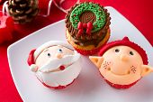 Three Christmas cupcakes on plate