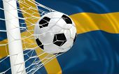 foto of sweden flag  - Sweden flag and soccer ball football in goal net - JPG