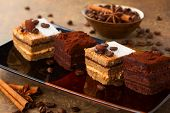 stock photo of buffet  - Coffee cream  small cakes and chocolate truffle cakes - JPG