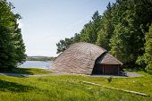 stock photo of longhouse  - A viking longhouse on the coast of Norway - JPG