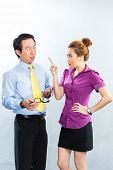 Asian Business - crisis or bullying under colleagues or boss and employee at the office