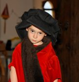 Serious Cute Little Boy In Medieval Costume Standing poster