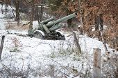image of artillery  - Defence line artillery sitting idle in winter snow - JPG