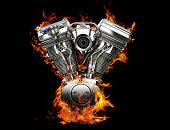 stock photo of chopper  - Chromed motorcycle engine on fire on a black background - JPG