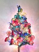 Christmas Tree With Garlands And Lights On